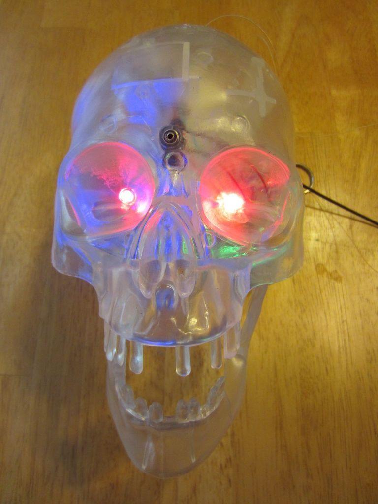 Animated Scary Motorized Skull Moves LED Lights Halloween Prop